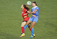 Portland, Oregon - Wednesday June 22, 2016: Portland Thorns FC forward Hayley Raso (21) and Chicago Red Stars midfielder Taylor Comeau (7) head the ball during a regular season National Women's Soccer League (NWSL) match at Providence Park.