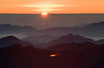 Sunrise from Pico Duarte (10.127'), the highest mountain in the Dominican Republic, above the clouds and the Cordillera Central mountain range