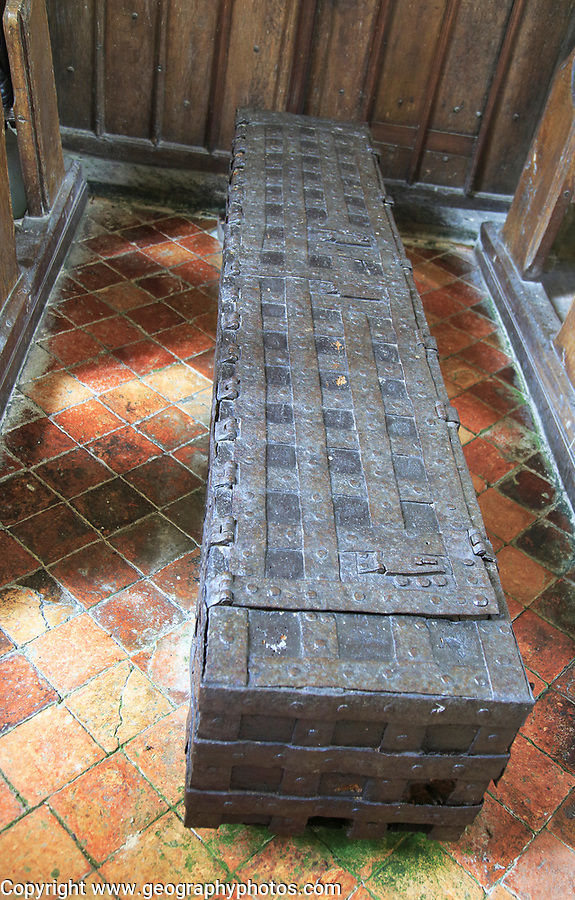 Historic metal storage trunk for valuables, church of Saint Peter, Monk Soham, Suffolk, England, UK