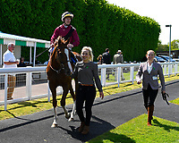 Winner of The Smith & Williamson British EBF Fillies' Handicap (Class 3), Time Change ridden by Richard Kingscote and trained by Ralph Beckett  enter the winners enclosure during Afternoon Racing at Salisbury Racecourse on 17th May 2018