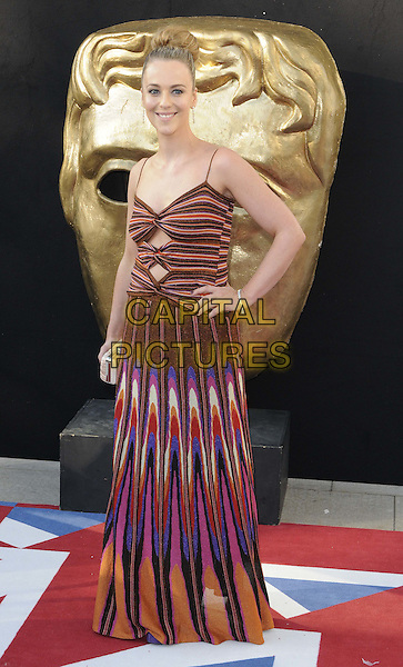 Miranda Raison.Arrivals at the Arqiva British Academy Television Awards held at the Royal Festival Hall, London, England..May 27th, 2012.BAFTA BAFTAS full length brown yellow pink blue print pattern dress hand on hip.CAP/CAN.©Can Nguyen/Capital Pictures.