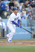 05/13/15 Los Angeles, CA: Los Angeles Dodgers left fielder Alex Guerrero #7during an MLB game played at Dodger Stadium between the Miami Marlins and The Los Angeles Dodgers. The Marlins defeated the Dodgers 5-4