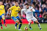 Isco Alarcon of Real Madrid (R) fights for the ball with Michel Macedo Rocha Machado of UD Las Palmas (L) during the La Liga 2017-18 match between Real Madrid and UD Las Palmas at Estadio Santiago Bernabeu on November 05 2017 in Madrid, Spain. Photo by Diego Gonzalez / Power Sport Images