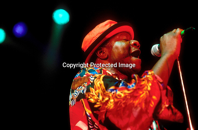 EVMUSIC06199.Events. Music. Johannesburg. Papa Wemba from Congo in colourful dress performing on stage. 95..©Per-Anders Pettersson / iAfrika Photos
