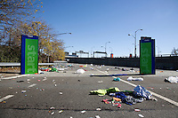 "The ""green"" start, littered with discarded clothing and other trash, on the on-ramp to the Verrazano-Narrows Bridge after the start of the ING New York City Marathon on Staten Island on 07 November 2010."