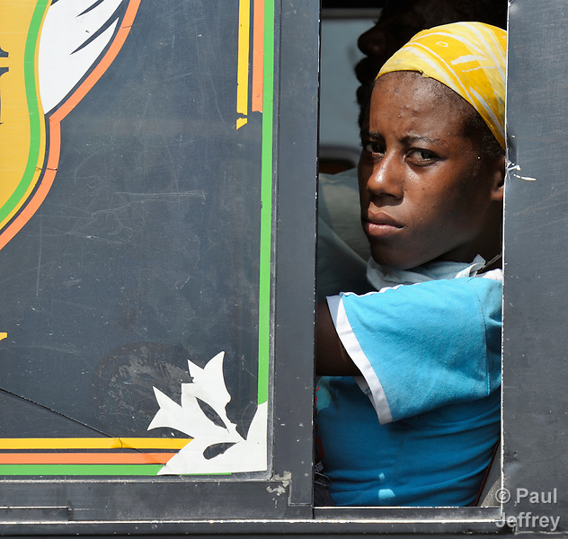 A woman rides a bus out of Port-au-Prince, Haiti, which was devastated by a January 12 earthquake. Tens of thousands of capital city residents are reportedly fleeing to the countryside.