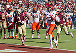 Syracuse quarterback Eric Dungey walkes into the end zone unchallenged in the second half of an NCAA college football game against Florida State in Tallahassee, Fla., Saturday, Nov. 4, 2017. Florida State defeated Syracuse 27-24. (AP Photo/Mark Wallheiser)
