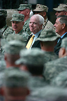 "Baghdad, Iraq, July 4, 2007, File Photo<br /> <br /> Sen. John McCain attends the Multi-National Force - Iraq reenlistment, naturalization and Independence Day ceremony at the Al-Faw Palace in Baghdad, Iraq, July 4, 2007, along with Senator Lindsey Graham. Both Senators were guest speakers for the ceremony  that reenlisted 571 servicemembers gave citizenship to 161. (U.S. Navy photo by Mass Communication Specialist 2nd Class Jennifer A. Villalovos) (Released) <br /> <br /> <br /> John Sidney McCain III (born August 29, 1936) is the senior United States Senator from Arizona and presumptive Republican Party nominee for President of the United States in the 2008 election.<br /> <br /> McCain graduated from the United States Naval Academy in 1958 and became a naval aviator, flying ground-attack aircraft from aircraft carriers. During the Vietnam War, he nearly lost his life in the 1967 USS Forrestal fire. Later that year while on a bombing mission over North Vietnam, he was shot down, badly injured, and captured as a prisoner of war by the North Vietnamese. He was held from 1967 to 1973, experiencing episodes of torture and refusing an out-of-sequence early repatriation offer; his war wounds would leave him with lifelong physical limitations.<br /> <br /> He retired from the Navy as a captain in 1981 and, moving to Arizona, entered politics. He was elected to the U.S. House of Representatives in 1982. After serving two terms, he was elected to the U.S. Senate in 1986, winning re-election easily in 1992, 1998, and 2004. While generally adhering to conservative principles, McCain has gained a media reputation as a ""maverick"" for disagreeing with his party on several key issues. After being investigated in a political influence scandal of the 1980s, as a member of the ""Keating Five"", he made campaign finance reform one of his signature concerns, which eventually led to the passage of the McCain-Feingold Act in 2002. He is also known for his work towards restoring diplomatic relations with Vietnam in the 1990s, and for his bel"