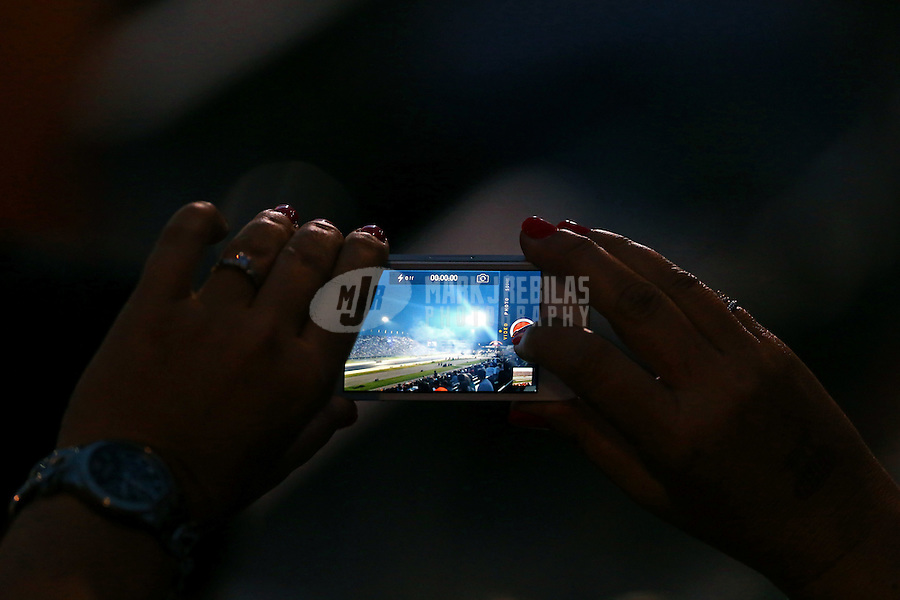 Aug 30, 2014; Clermont, IN, USA; Detailed view as an NHRA fan takes video with her iPhone in the grandstands during qualifying for the US Nationals at Lucas Oil Raceway. Mandatory Credit: Mark J. Rebilas-USA TODAY Sports