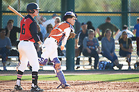 Timothy Wilson (16) of Center Hill High School in Olive Branch, Mississippi at bat as catcher Raul Aragon (4) of Paschal High School in Fort Worth, Texas throws down during the Baseball Factory All-America Pre-Season Tournament, powered by Under Armour, on January 14, 2018 at Sloan Park Complex in Mesa, Arizona.  (Art Foxall/Four Seam Images)
