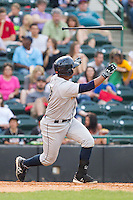 Jackson Valera (27) of the Charleston RiverDogs loses his grip on his bat during the game against the Hicory Crawdads at L.P. Frans Stadium on May 25, 2014 in Hickory, North Carolina.  The RiverDogs defeated the Crawdads 17-10.  (Brian Westerholt/Four Seam Images)
