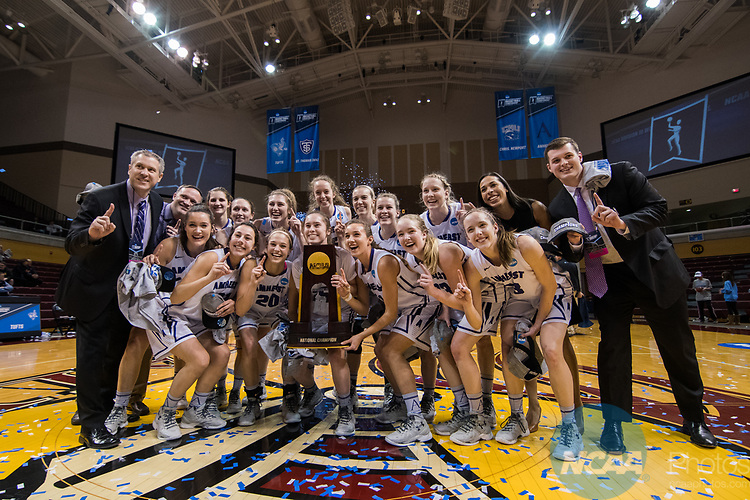 GRAND RAPIDS, MI - MARCH 18: Amherst College poses with their national championship trophy during the Division III Women's Basketball Championship held at Van Noord Arena on March 18, 2017 in Grand Rapids, Michigan. Amherst College defeated Tufts University 52-29 for the national title. (Photo by Brady Kenniston/NCAA Photos via Getty Images)