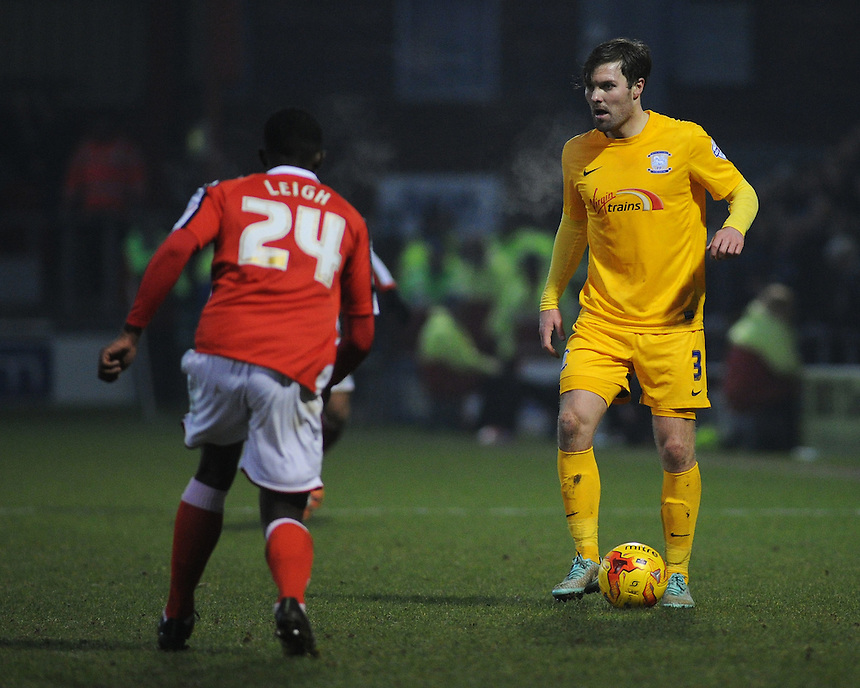 Preston North End's Scott Laird under pressure from Crewe Alexandra's Greg Leigh<br /> <br /> Photographer Kevin Barnes/CameraSport<br /> <br /> Football - The Football League Sky Bet League One - Crewe Alexandra v Preston North End - Sunday 28th December 2014 - Alexandra Stadium - Crewe<br /> <br /> &copy; CameraSport - 43 Linden Ave. Countesthorpe. Leicester. England. LE8 5PG - Tel: +44 (0) 116 277 4147 - admin@camerasport.com - www.camerasport.com