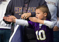 A young Husky fan practices his kung fu.  Just in case.
