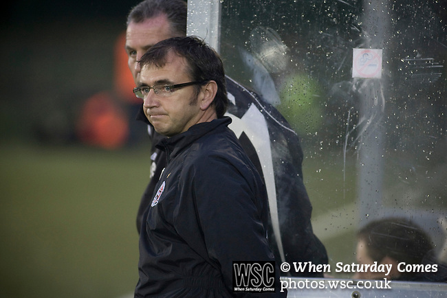 The New Saints 4 Bohemians 0, 20/07/2010. Park Hall Stadium, Champions League 2nd qualifying round 2nd leg. Pat Fenlon, manager of Irish club Bohemians watching the action through the rain at Park Hall Stadium, Oswestry during his team's Champions League 2nd qualifying round 2nd leg game away to The New Saints. Despite leading 1-0 from the first leg, the Dublin club went out following their 4-0 defeat by the Welsh champions. The match was the first-ever Champions League match in the UK played on an artificial pitch and was staged at the Welsh Premier League's ground which was located over the border in England. Photo by Colin McPherson.