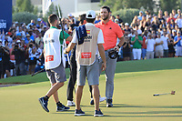 Jon Rahm (ESP) celebration on the18th green during the final round of the DP World Championship, Earth Course, Jumeirah Golf Estates, Dubai, UAE. 24/11/2019<br /> Picture: Golffile | Phil INGLIS<br /> <br /> <br /> All photo usage must carry mandatory copyright credit (© Golffile | Phil INGLIS)