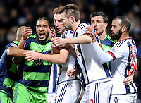 Ashley Williams of Swansea City battles with Gareth McAuley of West Bromwich Albion and Craig Dawson of West Bromwich Albion at a corner with arms and holding everywhere during the Barclays Premier League match between West Bromwich Albion and Swansea City at The Hawthorns on the 2nd of February 2016