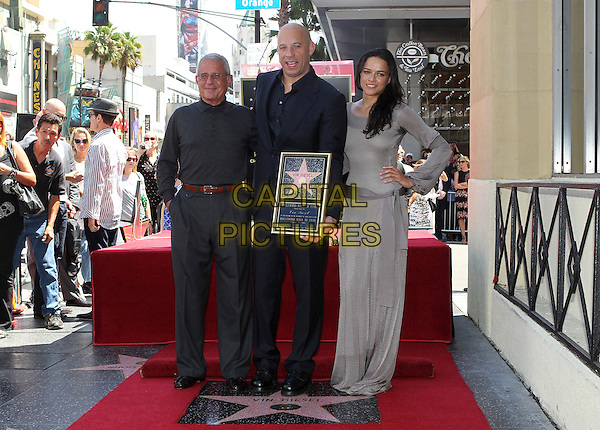 Ron Meyer, Vin Diesel, Michelle Rodriguez<br /> Vin Diesel honored with star on the Hollywood Walk Of Fame held on the Hollywood Walk Of Fame, Hollywood, California, USA.<br /> August 26th, 2013<br /> full length black suit plaque shirt trousers grey gray dress hand on hip  <br /> CAP/ADM/KB<br /> &copy;Kevan Brooks/AdMedia/Capital Pictures