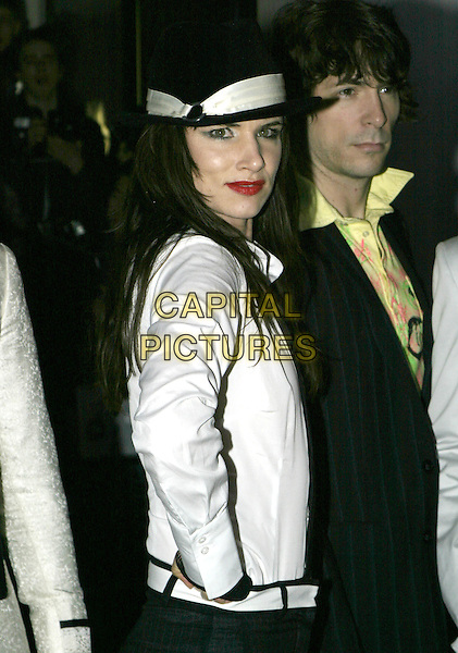 JULIETTE LEWIS.The Shockwaves NME Awards 2005,.Hammersmith Palais, Shepherds Bush Road,.London, February 17th 2005..half length white shirt black hat juliet.Ref: AH.www.capitalpictures.com.sales@capitalpictures.com.©Capital Pictures.
