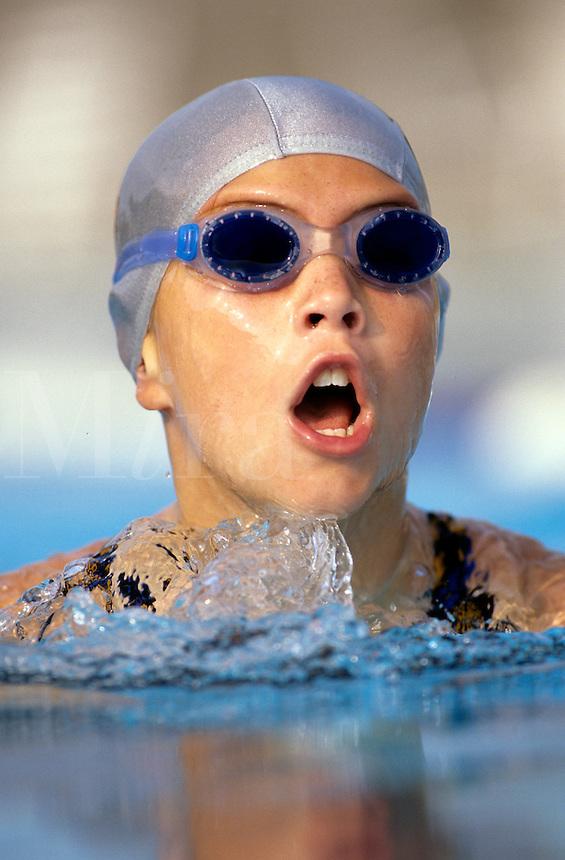 Young girl during a swim meet race.