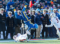Annapolis, MD - DEC 28, 2017: Navy Midshipmen running back John Brown III (20) goes airborne after the hit by Virginia Cavaliers safety Brenton Nelson (28) during game between Virginia and Navy at the Military Bowl presented by Northrop Grunman at Navy-Marine Corps Memorial Stadium Annapolis, MD. (Photo by Phil Peters/Media Images International)