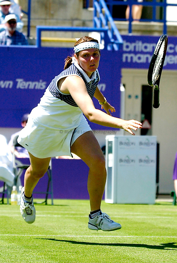 Photo. Rene Solari..20/6/01  .Eastbourne Tennis Day 3. France Natalie Tauziat playing against Thai Tamarine Tanasugarn throws her racket at the ball as she struggles to make it across the court in time. ...