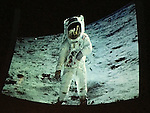 Garden City, New York, USA. October 23, 2015. Photo of astronaut Edwin BUZZ ALDRIN, in spacesuit walking on lunar surface, was taken by Neil Armstrong on July 20, 1969, during Apollo 11 mission. It's sometimes misidentified as being photo of Armstrong, explained Aldrin, the second person to walk on the moon. The audience saw the photo projected on the dome of the jetBlue Sky Theater Planetarium at Long Island's Cradle of Aviation Museum. Then Aldrin signed copies of his new Children's Middle Grade book Welcome to Mars: Making a Home on the Red Planet.