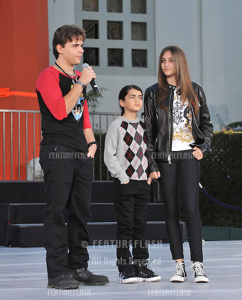 "Michael Jackson's children Prince Michael, Paris & Prince Michael II ""Blanket"" on Hollywood Boulevard where they placed their father's hand & footprints, using his shoes & glove, in cement in the courtyard of the Grauman's Chinese Theatre..Cirque du Soleil's new show ""Michael Jackson THE IMMORTAL World Tour"" premieres in Los Angeles tomorrow..January 26, 2012  Los Angeles, CA.Picture: Paul Smith / Featureflash"