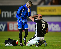 Lincoln City's Matt Rhead receives treatment for an injury from Lincoln City's head of sports science and medicine Mike Hine<br /> <br /> Photographer Chris Vaughan/CameraSport<br /> <br /> The EFL Sky Bet League Two Play Off Second Leg - Exeter City v Lincoln City - Thursday 17th May 2018 - St James Park - Exeter<br /> <br /> World Copyright &copy; 2018 CameraSport. All rights reserved. 43 Linden Ave. Countesthorpe. Leicester. England. LE8 5PG - Tel: +44 (0) 116 277 4147 - admin@camerasport.com - www.camerasport.com