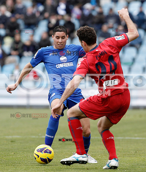 Getafe's Abdel Barrada (l) and Osasuna's Damia Abella during La Liga match.December 15,2012. (ALTERPHOTOS/Acero) /NortePhoto