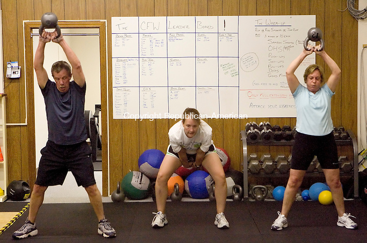 WATERTOWN, CT- 01 MAY 2008 --050108JS29-Rich Boucher, Becky Trazaski and Mary Boucher work with the kilo-balls during their workout at CrossFit in Watertown on Thursday. <br /> Jim Shannon / Republican-American