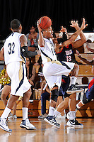 25 February 2012:  FIU guard DeJuan Wright (14) passes the ball while colliding with South Alabama guard-forward Mychal Ammons (13) in the first half as the FIU Golden Panthers defeated the University of South Alabama Jaguars, 81-74, at the U.S. Century Bank Arena in Miami, Florida.