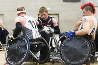 27 MAY 2013 - DONCASTER, GBR - Jim Roberts (centre) of West Coast Crash battles to keep the ball from Aaron Phipps (left) and David Anthony (right) of the South Wales Pirates during the 2013 Great Britain Wheelchair Rugby Nationals bronze medal match at The Dome in Doncaster, South Yorkshire .(PHOTO (C) 2013 NIGEL FARROW)