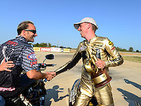 Sept. 23, 2012; Ennis, TX, USA: NHRA pro stock motorcycle rider Michael Ray (right) is congratulated by team owner Matt Smith as they celebrate after winning the Fall Nationals at the Texas Motorplex. Mandatory Credit: Mark J. Rebilas-US PRESSWIRE