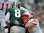 University of Wisconsin linebacker Blake Sorenson (9) hits Michigan State University quarterback Kirk Cousins (8) just as he released the ball during a game at Spartan Stadium in East Lansing, MI on October 13, 2010. (Photo by Bob Campbell)