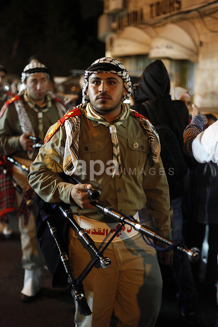 """Palestinian scouts play musical instruments as they parade through the streets during a celebrate the Eid-al-Adha, or """"Feast of Sacrifice,"""" in Jerusalem city on October 13, 2013. Millions of Muslims around the world celebrate Eid al-Adha or Feast of the Sacrifice, which marks the end of the annual hajj or pilgrimage to Mecca and celebrates Abraham's readiness to sacrifice his son to God. Photo by Saeed Qaq"""