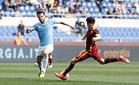 Calcio, Serie A: Lazio vs Roma. Roma, stadio Olimpico, 3 aprile 2016.<br /> Roma's Stephan El Shaarawy, right, is challenged by Lazio's Marco Parolo during the Italian Serie A football match between Lazio and Roma at Rome's Olympic stadium, 3 April 2016.<br /> UPDATE IMAGES PRESS/Isabella Bonotto