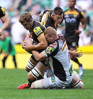 Sam Jones is tackled to ground. Aviva Premiership Double Header match, between London Wasps and Harlequins on September 7, 2013 at Twickenham Stadium in London, England. Photo by: Patrick Khachfe / Onside Images