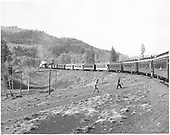 2 locomotives and 10 cars eastbound heading to Cumbres - Rocky Mountain R.R. Club excursion.<br /> D&amp;RGW  Chama to Cumbres, NM  5/31/1952