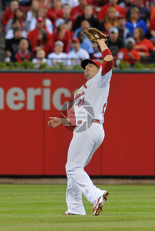 18 May 2011                            St. Louis Cardinals shortstop Ryan Theriot (3) catches a pop fly as he was running towards the outfield.  The St. Louis Cardinals defeated the Houston Astros 5-1 on Wednesday May 18, 2011 in the first game of a two-game series at Busch Stadium in downtown St. Louis.