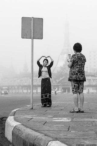 In front of the Sule Pagoda.<br /> Yangon, Myanmar. 2014