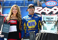 Sept. 22, 2012; Ennis, TX, USA: NHRA funny car shootout drivers (R-L) Robert Hight and Ron Capps during qualifying for the Fall Nationals at the Texas Motorplex. Mandatory Credit: Mark J. Rebilas-