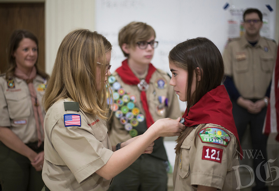 NWA Democrat-Gazette/CHARLIE KAIJO Annabella Rose Tyburski (left) wraps a Scouts neckerchief around Ruby Freeman (right) during a crossover ceremony, Saturday, February 2, 2019 at the First Presbyterian Church in Bentonville.