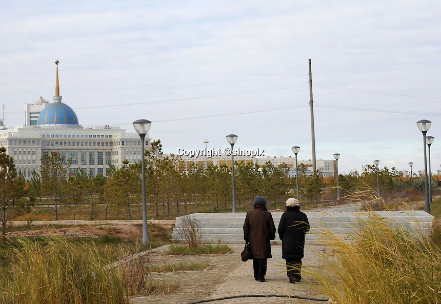 A couple walk in the unfinished park near the presidential palace in Astana, the capitol of Kazakhstan.
