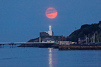 2020 05 07 Flower Moon rising over Mumbles lighthouse near Swansea, Wales, UK.