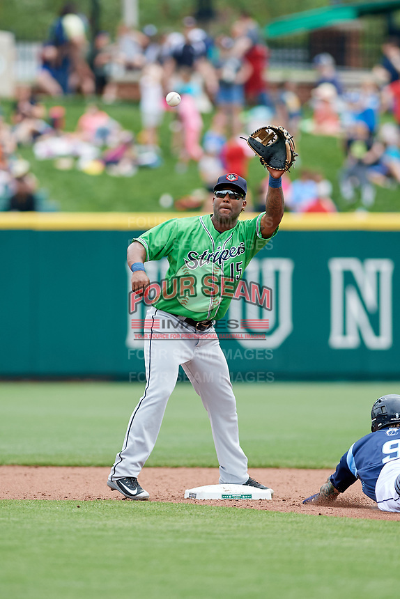Gwinnett Stripers second baseman Danny Santana (15) stretches to receive a throw on a stolen base attempt as Brandon Barnes (9) slides into second base during a game against the Columbus Clippers on May 17, 2018 at Huntington Park in Columbus, Ohio.  Gwinnett defeated Columbus 6-0.  (Mike Janes/Four Seam Images)
