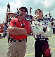 NASCAR driver Jeff Gordon (right) takes time out from practice at Daytona International Speedway to stand with a NASCAR official and watch space shuttle Endeavour blast off from Kenneday Space Center 2/11/00.  Gordon is in Daytona, which is 50 miles from Kennedy Space Center, to prepare for the 2000 Daytona 500.(Photo by Brian Cleary)