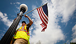 SOUTHBURY,  CT-052019JS02- Jack Battaglia an Outside Properties workers for the Town of Southbury's Department of Public Works and Nick Brennan, were busy Monday putting up American flags on both sides of Main Street in Southbury as the town prepares for the upcoming Memorial Day weekend. <br /> Jim Shannon Republican American