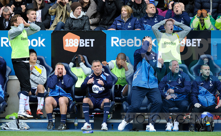 Owen Coyle manager of Bolton Wanderers and the rest of the bench react to a missed chance to score.Barclays Premier League match between Bolton Wanderers v Swansea City at The Reebok Stadium, Bolton on the 21st April 2012..Sportimage +44 7980659747.picturedesk@sportimage.co.uk.http://www.sportimage.co.uk/.