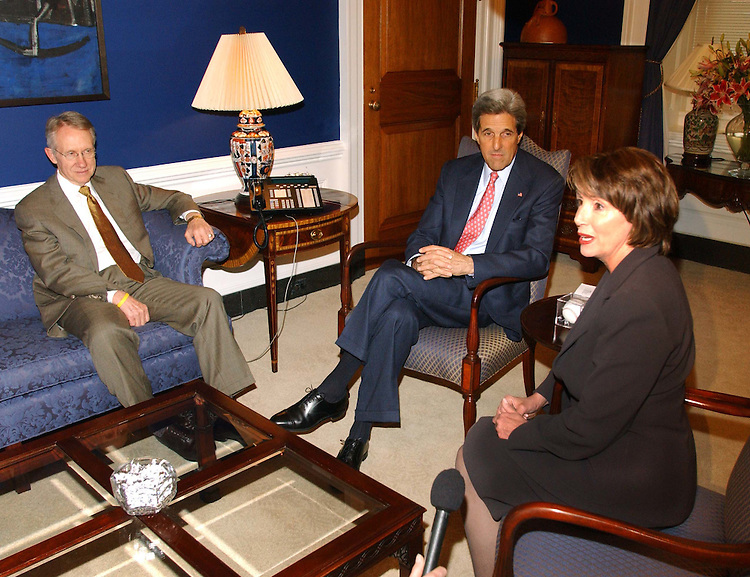 11/9/04.KERRY MEETING WITH DEMOCRATIC LEADERS--House Minority Leader Nancy Pelosi of California, right, during a photo opp during her meeting with Nevada Sen. Harry Reid, left, expected to be the new minority leader, and Massachusetts Sen. John Kerry, the defeated Democratic presidential nominee, in her office..CONGRESSIONAL QUARTERLY PHOTO BY SCOTT J. FERRELL